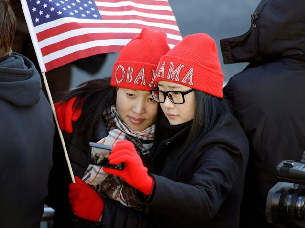 Khongorzul Battsengel (left) and Ariunbolor Davaatsogt from Mongolia snapped pictures of themselves at the uniquely American event. (Andrew Harnik/The Washington Times)