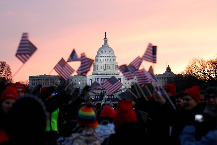 Supporters of President Obama wave American flags on the National Mall in Washington on Jan. 21, 2013, prior to the start of the president's ceremonial swearing-in during the 57th Presidential Inauguration. (Associated Press)