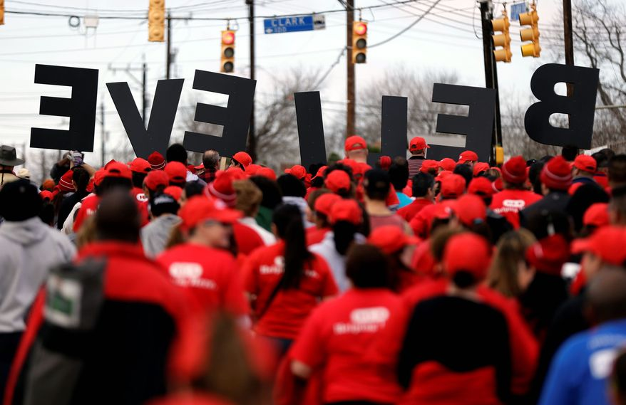 """A group carries letters spelling """"BELIEVE"""" as they take part in a march honoring Martin Luther King Jr., on Monday in San Antonio. (Associated Press)"""