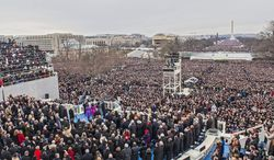 Before a crowd stretching down the Mall, President Obama takes the oath of office and gives a relatively brief inaugural address. (Andrew S. Geraci/The Washington Times)