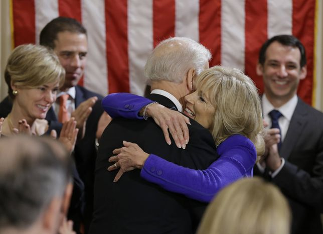 ** FILE ** Vice President Joseph R. Biden hugs his wife Jill Biden after taking the oath of office during and official ceremony at the Naval Observatory, Sunday, Jan. 20, 2013, in Washington. Mr. Biden was sworn in for a second term using the Biden family Bible. (AP Photo/Carolyn Kaster)