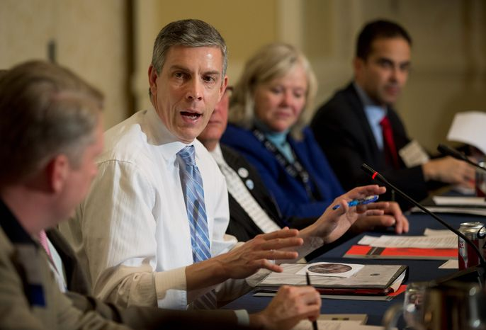 """""""If you drop out of high school, how many good jobs are there out there for you? None. That wasn't true 10 or 15 years ago,"""" Education Secretary Arne Duncan said while discussing the national increase in high school graduation rates. (Associated Press)"""