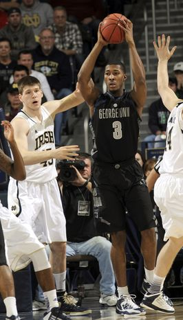 Georgetown forward Mikael Hopkins (3) throws a pass around Notre Dame forward Jack Cooley during the first half of Georgetown's 63-47 win on Jan. 21, 2013, in South Bend, Ind. (