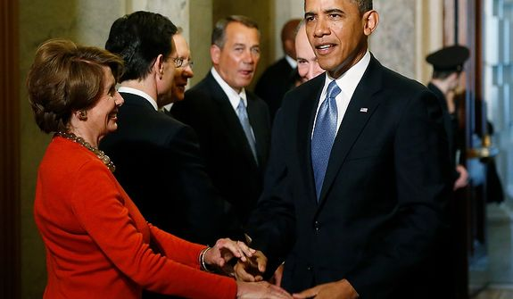 U.S. President Barack Obama (R) greets House Minority Leader Nancy Pelosi (D-CA) (L) as he arrives at the senate carriage entrance for swearing-in ceremonies at the U.S Capitol in Washington, January 21, 2013.   REUTERS/Jonathan Ernst