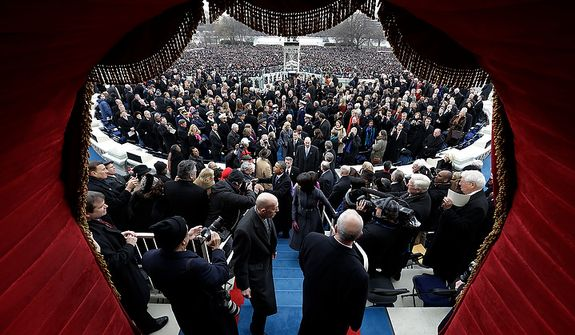 President Barack Obama and the first family leaves after the ceremonial swearing-in at the U.S. Capitol during the 57th Presidential Inauguration in Washington, Monday, Jan. 21, 2013. (AP Photo/Evan Vucci, Pool)