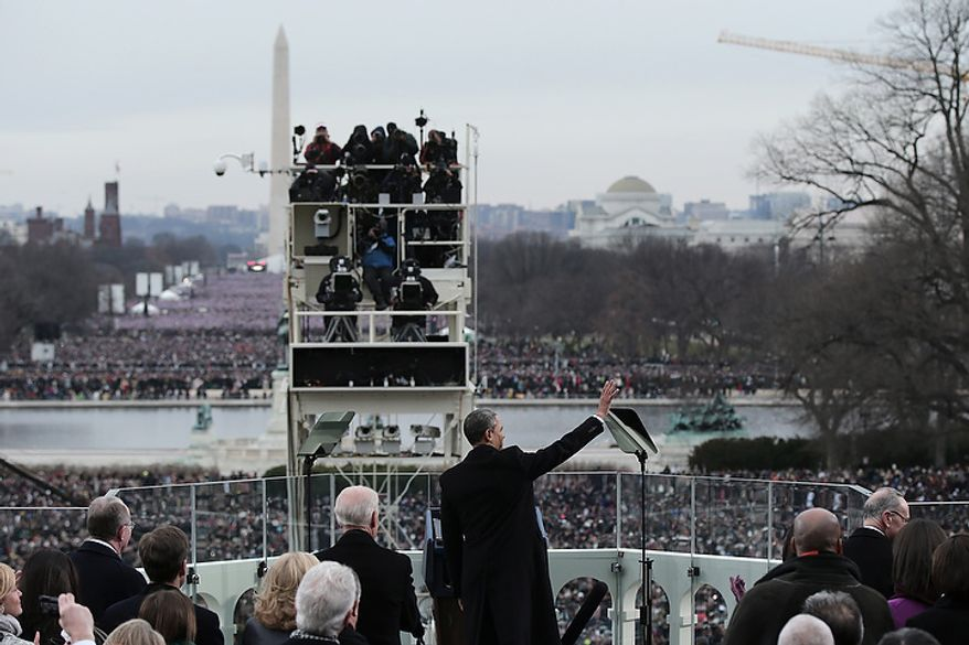 U.S. President Barack Obama waves during the public ceremonial inauguration on the West Front of the U.S. Capitol January 21, 2013 in Washington, DC.   Barack Obama was re-elected for a second term as President of the United States.  (Photo by POOL Win McNamee/Getty Images)