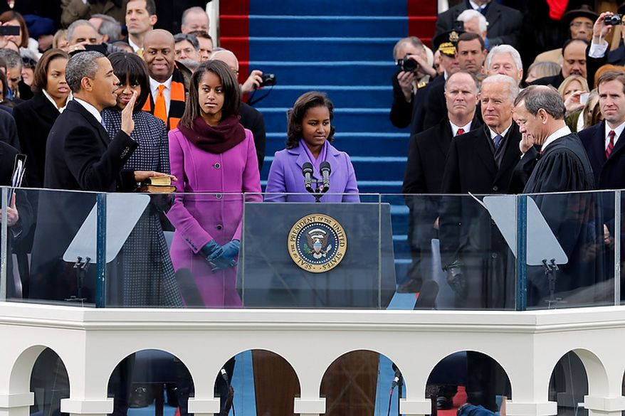 President Barack Obama takes the oath of office from Chief Justice John Roberts at the ceremonial swearing-in at the U.S. Capitol during the 57th Presidential Inauguration in Washington, Monday, Jan. 21, 2013. (AP Photo/Scott Andrews, Pool)