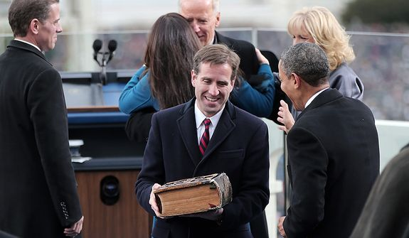 Beau Biden and U.S. President Barack Obama after U.S. Vice President Joe Biden is sworn in during the public ceremonial inauguration on the West Front of the U.S. Capitol January 21, 2013 in Washington, DC.   Barack Obama was re-elected for a second term as President of the United States.  (Photo by Win McNamee/Getty Images)