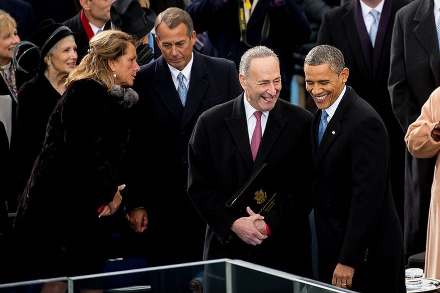 President Barack Obama talks with Sen. Charles E. Schumer (D-N.Y.) before being sworn in for his second term on the West Lawn of the U.S. Capitol Building at the 57th Presidential Inauguration Ceremony, Washington, D.C., Monday, January 21, 2013. (Andrew Harnik/The Washington Times)