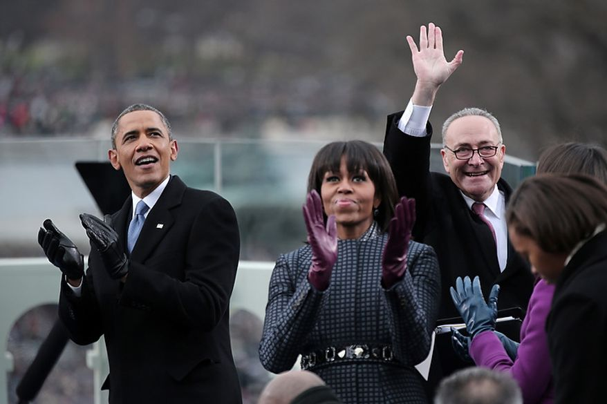 (L-R) U.S. President Barack Obama, First lady Michelle Obama and U.S. Sen. Charles Schumer (D-NY) clap during the presidential inauguration on the West Front of the U.S. Capitol January 21, 2013 in Washington, DC.   Barack Obama was re-elected for a second term as President of the United States.  (Photo by POOL Win McNamee/Getty Images)