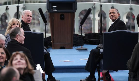 U.S. President Barack Obama (R) and U.S. Vice President Joe Biden sit during the presidential inauguration on the West Front of the U.S. Capitol January 21, 2013 in Washington, DC.   Barack Obama was re-elected for a second term as President of the United States.  (Photo by POOL Win McNamee/Getty Images)