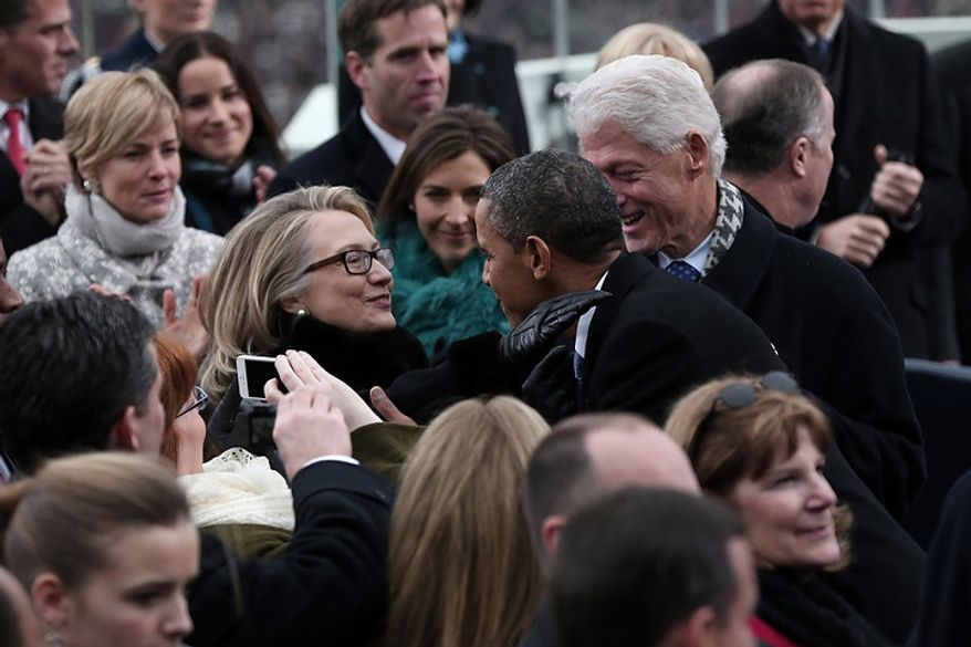 U.S. President Barack Obama greets Secretary of State Hillary Clinton and former president Bill Clinton during the presidential inauguration on the West Front of the U.S. Capitol January 21, 2013 in Washington, DC.   Barack Obama was re-elected for a second term as President of the United States.  (Photo by POOL Win McNamee/Getty Images)