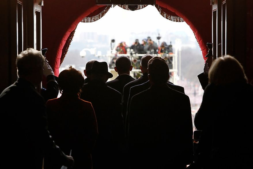 U.S. President Barack Obama (C) pauses with his escorts before walking through the Lower West Terrace Door of the U.S. Capitol to begin swearing-in ceremonies in Washington, January 21, 2013. REUTERS/Jonathan Ernst