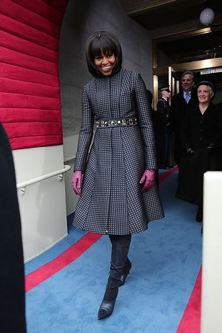 First lady Michelle Obama arrives during the presidential inauguration on the West Front of the U.S. Capitol January 21, 2013 in Washington, DC.   Barack Obama was re-el