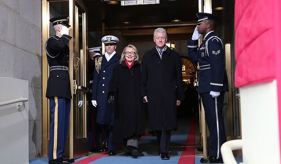 U.S. Secretary of State Hillary Clinton and former U.S. President Bill Clinton arrive during the presidential inauguration on the West Front of the U.S. Capitol January 21, 2013 in Washington, DC.   Barack Obama was re-elected for a second term as President of the United States.  (Photo by POOL Win McNamee/Getty Images)