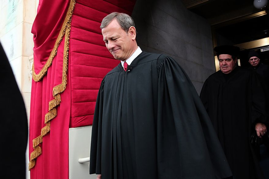 Supreme Court Chief Justice John Roberts arrives during the presidential inauguration on the West Front of the U.S. Capitol January 21, 2013 in Washington, DC.   Barack Obama was re-elected for a second term as President of the United States.  (Photo by POOL Win McNamee/Getty Images)