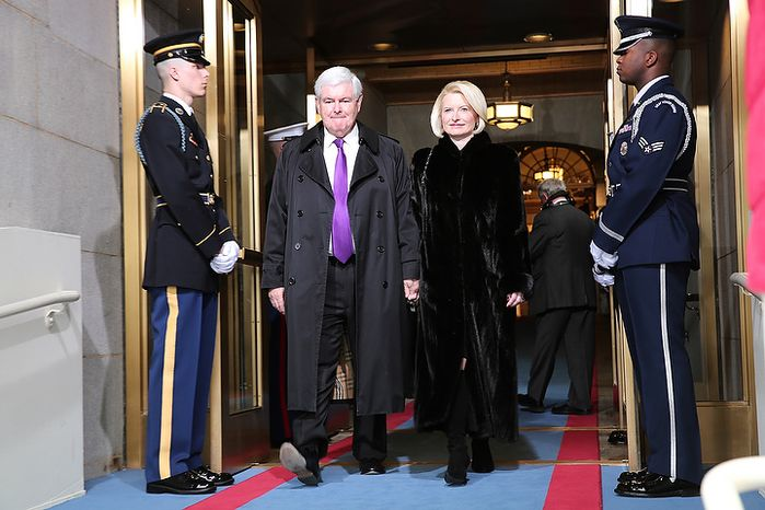 Former House Speaker Newt Gingrich and wife Callista Gingrich arrive for the presidential inauguration on the West Front of the U.S. Capitol January 21, 2013 in Washington, DC.   Barack Obama was re-elected for a second term as President of the United States.  (Photo by POOL Win McNamee/Getty Images)