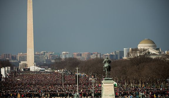 Thousands gather on the National Mall before President Barack Obama is sworn in for his second term on the West Lawn of the U.S. Capitol Building at the 57th Presidential Inauguration Ceremony, Washington, D.C., Monday, January 21, 2013. (Andrew Harnik/The Washington Times)