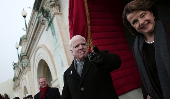 U.S. Senator John McCain (R-AZ) (L) and U.S. Sen. Dianne Feinstein (D-CA) gesture to U.S. Rep. Peter King before the presidential inauguration on the West Front of the U.S. Capitol January 21, 2013 in Washington, DC.   Barack Obama was re-elected for a second term as President of the United States.  (Photo by POOL Win McNamee/Getty Images)