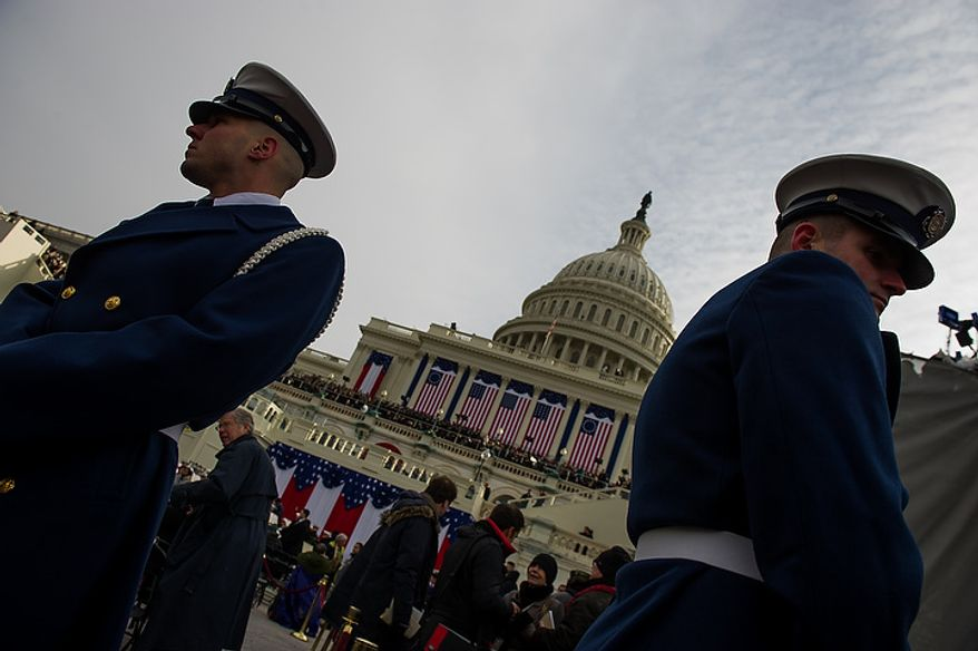 Members of the military stand on hand on the West Lawn of the U.S. Capitol Building before President Barack Obama is sworn in for his second term at the 57th Presidential Inauguration Ceremony, Washington, D.C., Monday, January 21, 2013. (Andrew Harnik/The Washington Times)