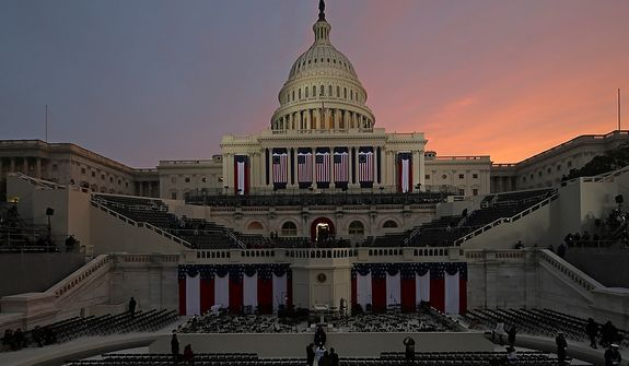The sunrises early in the morning before the ceremonial swearing-in of President Barack Obama at the U.S. Capitol during the 57th Presidential Inauguration in Washington, Monday, Jan. 21, 2013. (AP Photo/Scott Andrews, Pool)