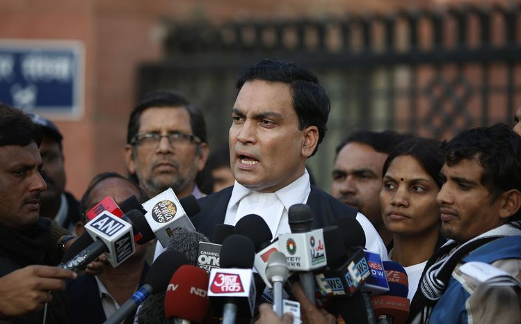 A.P Singh, lawyer for one of the accused, speaks to journalists outside the Saket district court complex where the five men facing charges of rape and murder of a 23-year-old woman aboard a moving bus in the capital last month stand trial, in New Delhi, India, Monday, Jan. 21, 2013. (AP Photo/ Saurabh Das)