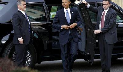 President Barack Obama smiles as he arrives at St. John's Church in Washington, Monday, Jan. 21, 2013, for a church service during the 57th Presidential Inauguration. (AP Photo/Jacquelyn Martin)