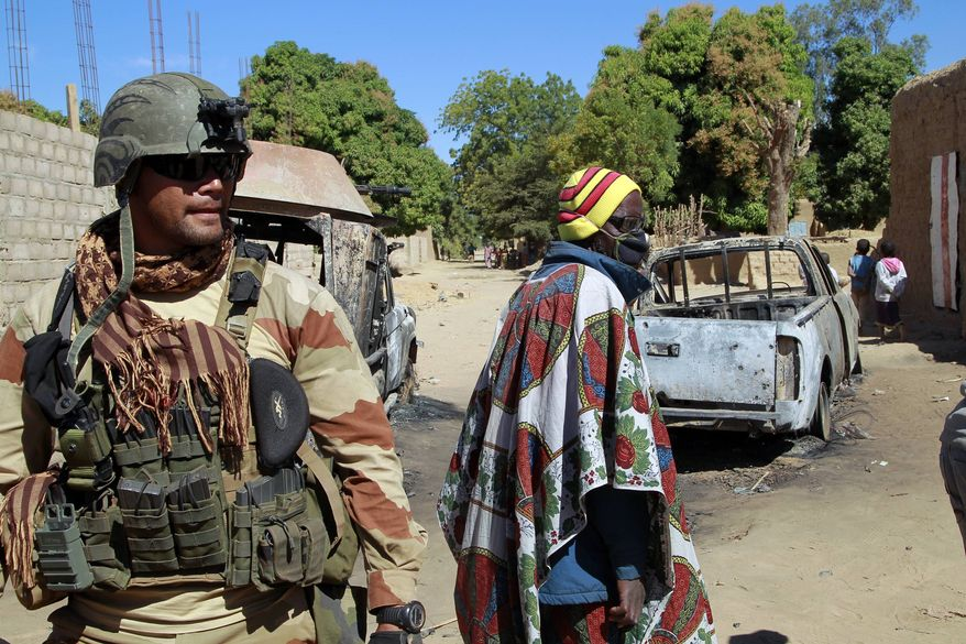 A French soldier secures a perimeter on the outskirt of Diabaly, Mali, some 460kms (320 miles) north of the capital Bamako Monday, Jan. 21, 2013. French and Malian troops were in the city whose capture by radical Islamists prompted the French military intervention. (AP Photo/Jerome Delay)