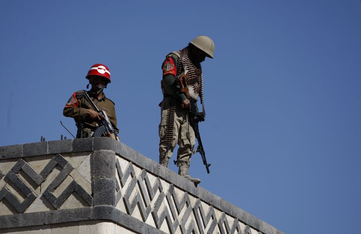 Yemeni soldiers stand guard on the rooftop of a state security court during a trial of suspected al Qaeda militants in Sanaa, Yemen, on Monday, Jan. 21, 2013. A Yemen security official said an explosion Sunday in the province