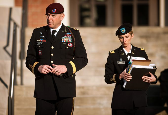 Army Brig. Gen. Jeffrey A. Sinclair (left) leaves a Fort Bragg courthouse with a member of his defense team, Maj. Elizabeth Ramsey, on Jan. 22, 2012, after he deferred entering a plea at his arraignment on charges of fraud, forcible sodomy, coercion and inappropriate relationships. Sinclair, who served five combat tours, is headed to trial following a spate of highly publicized milita