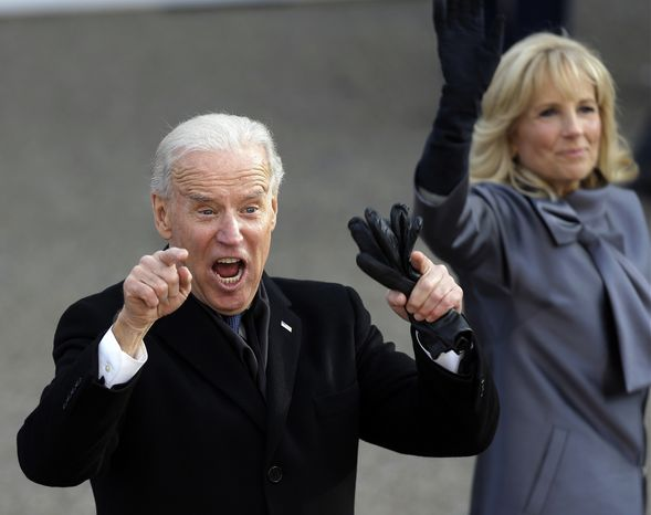 **FILE** Vice President Joseph R. Biden reacts Jan. 21, 2013, with his wife, Jill, as they walk down Pennsylvania Avenue en route to the White House during the 57th presidential inauguration parade after the ceremonial swearing-in of President Obama. (Associated Press)