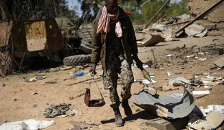 A Malian soldier walks Jan. 21, 2013, inside a military camp used by radical Islamists and bombarded by French warplanes in Diabaly, Mali, some 460 kilometers (320 miles) north of the capital Bamako. French and Malian troops took control Monday of the town of Diabaly, patrolling the streets in armored personnel carriers and inspecting the charred remains of a pickup truck with a mounted machine gun left behind by the fleeing militants. (Associated Press)