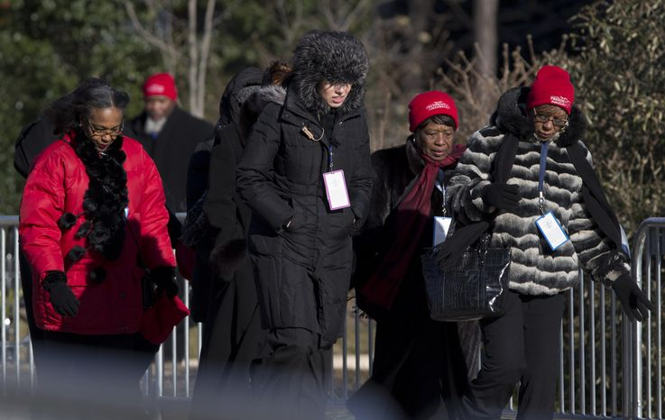 Bundled up people arrive in below freezing temperatures to attend the National Prayer Service at Washington National Cathedral in Washington on Jan. 22, 2013. President Obama, Vice President Biden and their families plan to attend the prayer service, a day after the 57th presidential inauguration. (Associated Press)