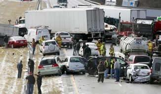 Semi-trucks and other vehicles involved in a multi-car crash are strewn across westbound Interstate 275 between Colerain Avenue and Hamilton Avenue on Jan. 21, 2013, in Cincinnati. The accident left about 20 people injured. (Associated Press)