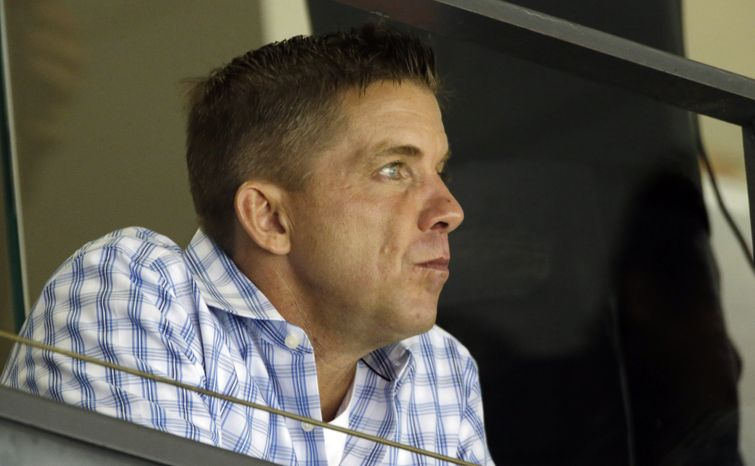 FILE - In this Oct. 7, 2012 file photo, suspended New Orleans Saints coach Sean Payton watches from the stands during an NFL football game between the Saints and the San Diego Chargers at the Mercedes-Benz Superdome in New Orleans. NFL Commissioner Roger Goodell has reinstated Payton following a season-long suspension for his role in