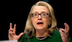 **FILE** Then-Secretary of State Hillary Rodham Clinton testifies on Capitol Hill on Jan. 23, 2013, before the Senate Foreign Relations Committee on the Sept. 11, 2012, attacks against the U.S. Consulate in Benghazi, Libya. (Andrew Harnik/The Washington Times)