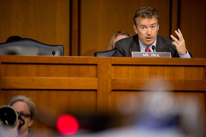 ** FILE ** Sen. Rand Paul, Kentucky Republican, questions Secretary of State Hillary Rodham Clinton as she testifies on Capitol Hill on Wednesday, Jan. 23, 2013, before the Senate Foreign Relations Committee on the Sept. 11, 2012, attacks against the U.S. Consulate in Benghazi, Libya. (Andrew Harnik/The Washington Times)
