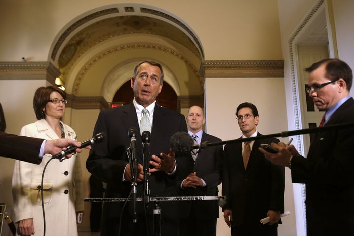 House Speaker John Boehner (center), Ohio Republican, speaks Jan. 23, 2013, during a news conference on Capitol Hill in Washington to discuss the debt limit. (