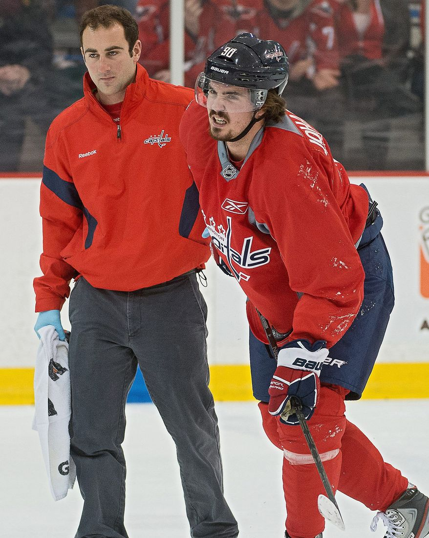 Washington Capitals center Marcus Johansson (90) is helped off the ice after colliding with Washington Capitals left wing Alex Ovechkin (8) during a scrimmage between the Washington Capitals and the Reading Royals at Kettler Capitals Iceplex, Arlington,Va., Tuesday, January 8, 2013. (Andrew Harnik/The Washington Times)