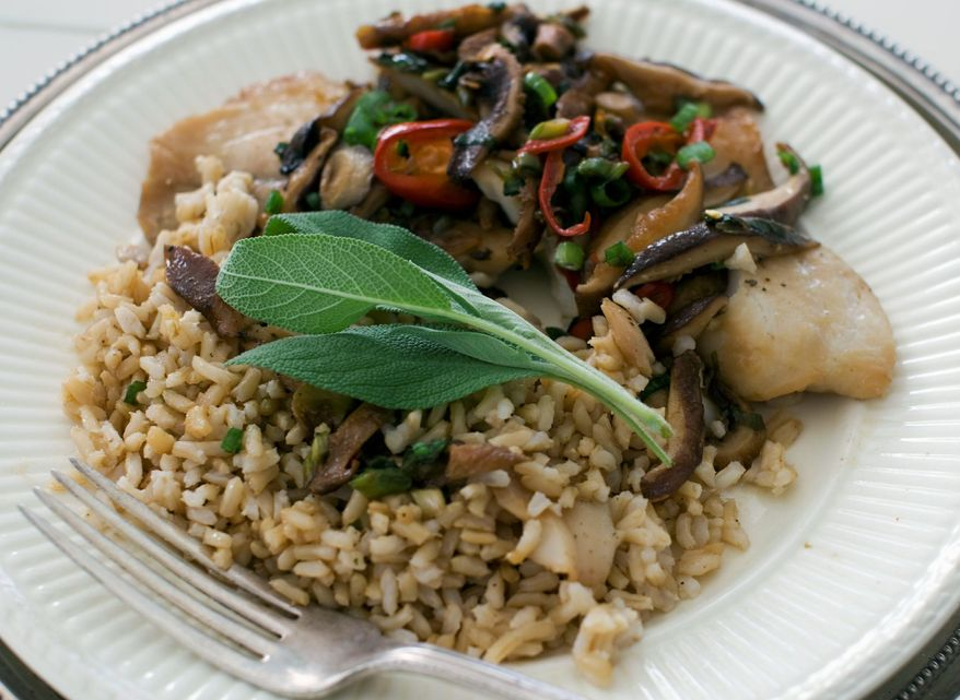 Chinese-style steamed tilapia is topped with a sauce made with shiitake mushrooms. (Associated Press)