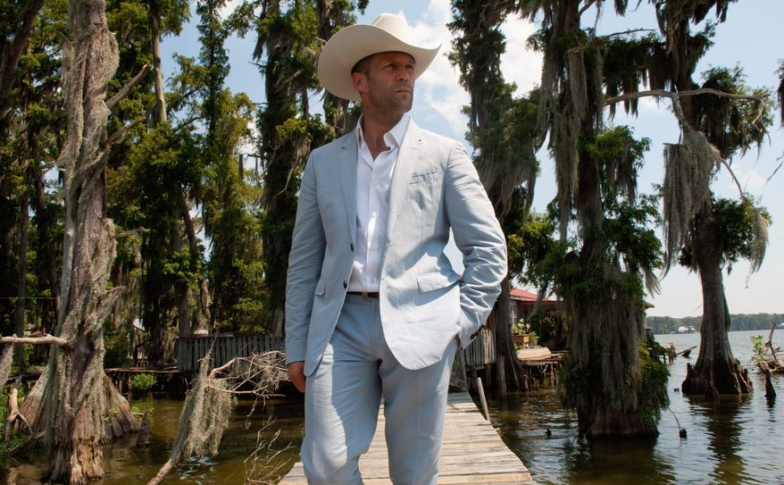 "Jason Statham's character in ""Parker"" poses as a Texas oilman looking to buy a house in Florida, where his former gang has relocated while planning a $75 million heist. (Film District via Associated Press)"
