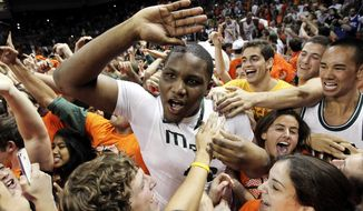 Miami's Reggie Johnson celebrates with fans after defeating Duke 90-63 in an NCAA college basketball game in Coral Gables, Fla., Wednesday, Jan. 23, 2013. (AP Photo/The Miami Herald, Charlie Trainor)