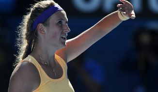 Victoria Azarenka of Belarus waves to the crowd after winning her semifinal match against Sloane Stephens of the US at the Australian Open tennis championship in Melbourne, Australia, Thursday, Jan. 24, 2013. (AP Photo/Andrew Brownbill)