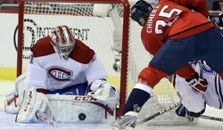 Montreal Canadiens goalie Carey Price (31) blocks a shot by Washington Capitals left wing Jason Chimera (25) in the first period of an NHL hockey game on Thursday, Jan. 24, 2013, at the Verizon Center in Washington. (AP Photo/Alex Brandon)