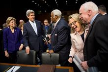 Sen. John F. Kerry (second from left) arrives alongside outgoing Secretary of State Hillary Rodham Clinton (second from right), Sen. John McCain (right) and Sen. Elizabeth Warren (left) for his confirmation hearing before the Senate Foreign Relations Committee to be the next secretary of state, on Capitol Hill in Washington on Thursday, Jan. 24, 2013. Mr. Kerry, the committee's chairman, is expected to receive overwhelming support from his colleagues. (Andrew Harnik/The Washington Times)