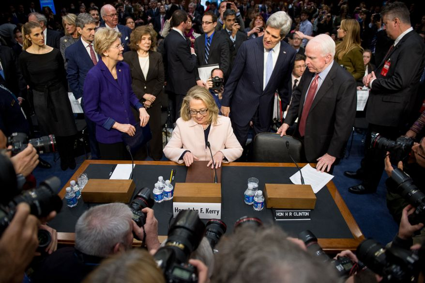 Sen. John F. Kerry (second from right) arrives for his confirmation hearing before the Senate Foreign Relations Committee to be the next secretary of state, on Thursday, Jan. 24, 2013, on Capitol Hill in Washington.  With him are outgoing Secretary of State Hillary Rodham Clinton (center), Sen. John McCain (right) and Sen. Elizabeth Warren (left). (Andrew Harnik/The Washington Times)