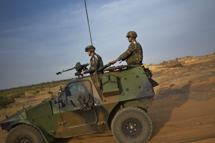 **FILE** French soldiers patrol in armored vehicles in the outskirts of Sevare, Mali, some 385 miles north of Bamako, the capital, on Jan. 23, 2013. (Associated Press)