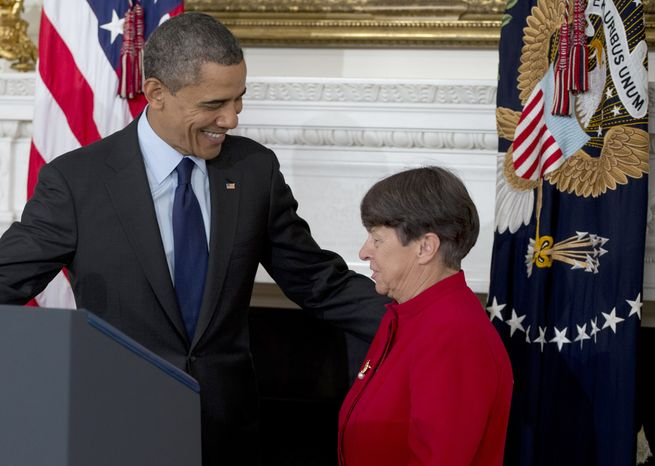 President Obama looks to Mary Jo White in the State Dining Room of the White House in Washington on Thursday, Jan. 24, 2013, as he announces he will nominate her to lead the Securities and Exchange Commission (SEC). (AP Photo/Carolyn Kaster)