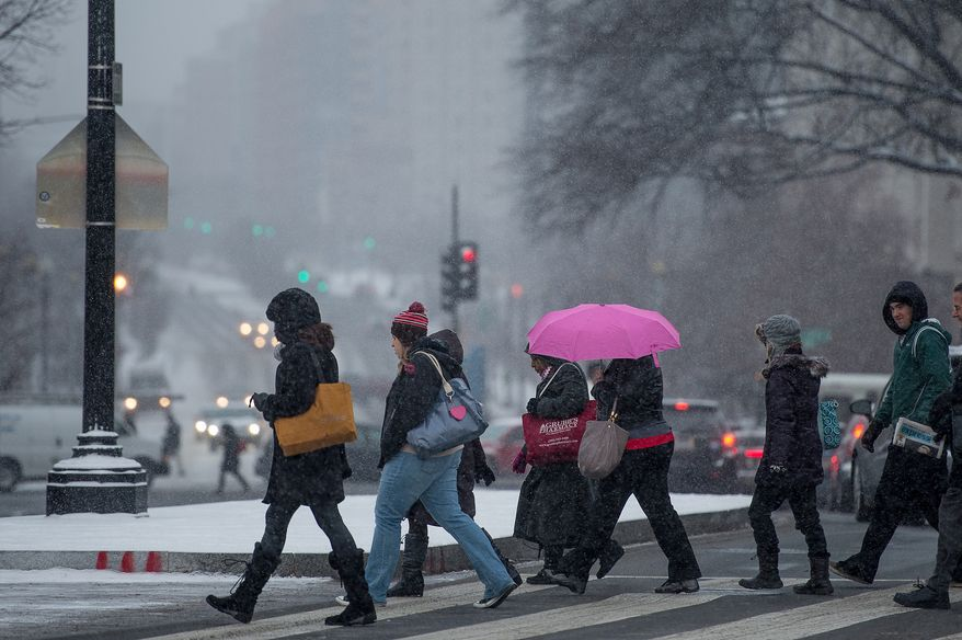 Light snow falls during morning rush hour at Union Station, Washington, D.C., Thursday, Jan. 24, 2013. (Andrew Harnik/The Washington Times)