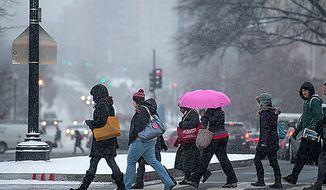 Light snow falls during morning rush hour at Union Station, Washington, D.C., Thursday, January 24, 2013. (Andrew Harnik/The Washington Times)